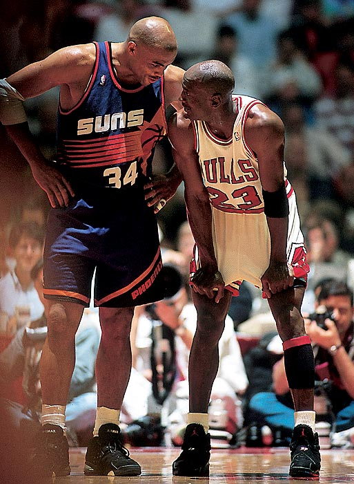 Taking a break from the action of the 1993 NBA Finals, Jordan and Charles Barkley chat in Game 5. Jordan averaged an NBA Finals-record 41 points in the series, becoming the first player to win three straight Finals MVPs.