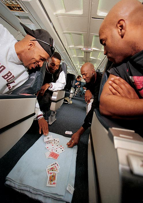 Michael Jordan, Ron Harper, Scottie Pippen and Scott Burrell plays whist on a Chicago Bulls team flight in March 1998. Jordan was in the midst of his fifth MVP season, in which he averaged a league-best 28.7 points per game.