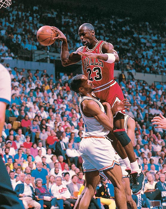 Jordan makes a pass in the face of Cleveland's Ron Harper in Game 5 of a first-round Eastern Conference series. Jordan finished the game with his famous jumper over Craig Ehlo at the buzzer to win the series.