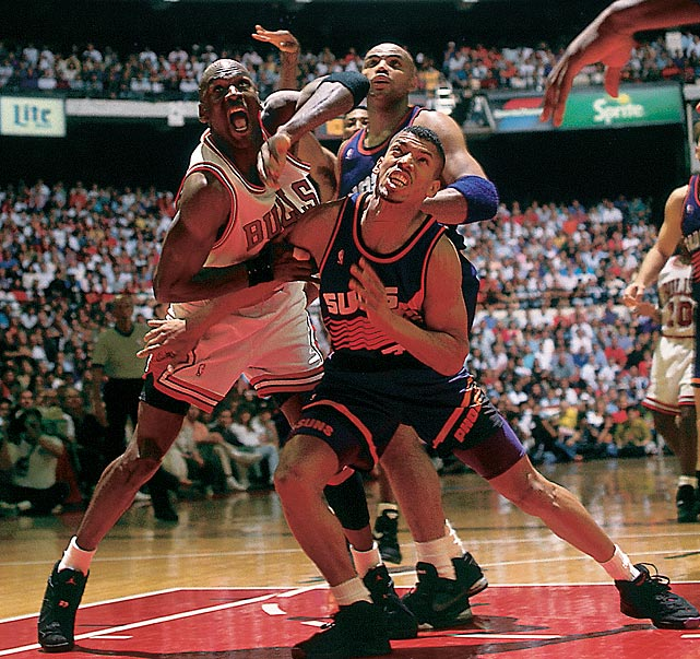 Michael Jordan and the Phoenix Suns' Kevin Johnson and Charles Barkley battle for position in Game 3 of the 1993 NBA Finals. Barkley beat out Jordan for the regular season MVP, but Jordan got the title as the Bulls beat the Suns in six games.