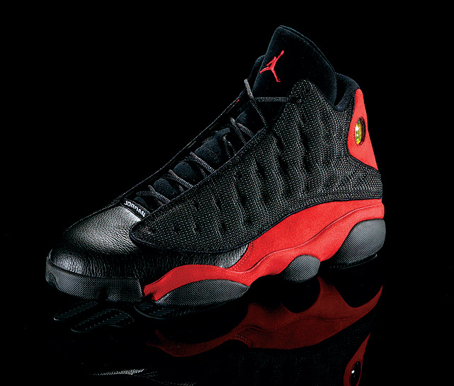 "The Air Jordan XIII, nicknamed the ""Black Cat"", mirrors the padding on a panther's paw and features a hologram panther's eye. Jordan wore the shoes as he completed his record 10th scoring title and his second three-peat."