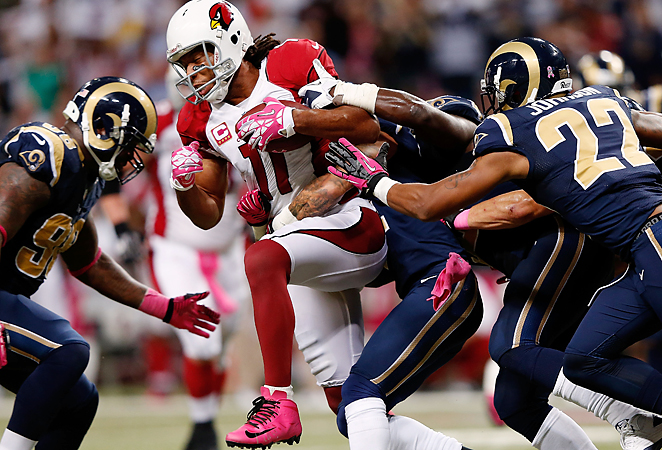 The Cardinals' revolving door at quarterback cut deeply into Larry Fitzgerald's production in 2012.