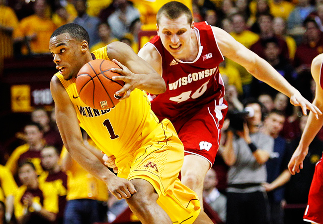 Andre Hollins and Minnesota knocked off Wisconsin in overtime on Thursday night.