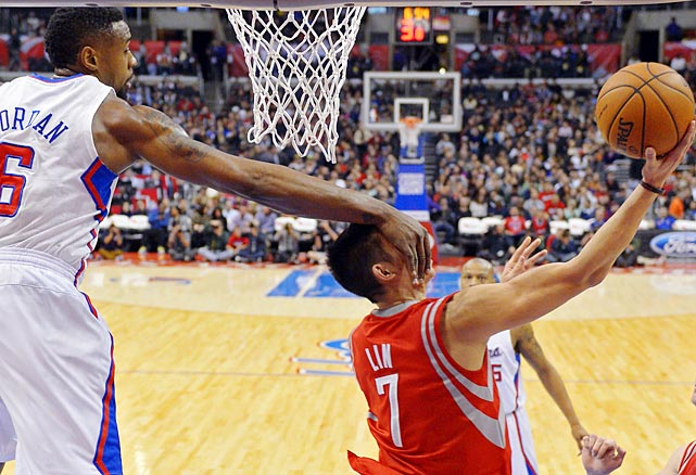 Jeremy Lin gets a slap of reality from DeAndre Jordan while attempting a shot.