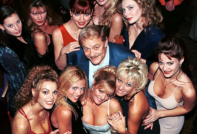 Buss smiles with the Penthouse Pets at the 30th anniversary party for Penthouse magazine in June 1999. Ever the playboy, Buss was rarely seen in public without at least one attractive woman alongside.