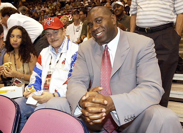 Buss sits with Magic Johnson at Game 3 of the 2002 NBA Finals between the Lakers and the New Jersey Nets. Johnson ran the point for the Lakers' reign of dominance in the 1980s, winning five championships for Buss.
