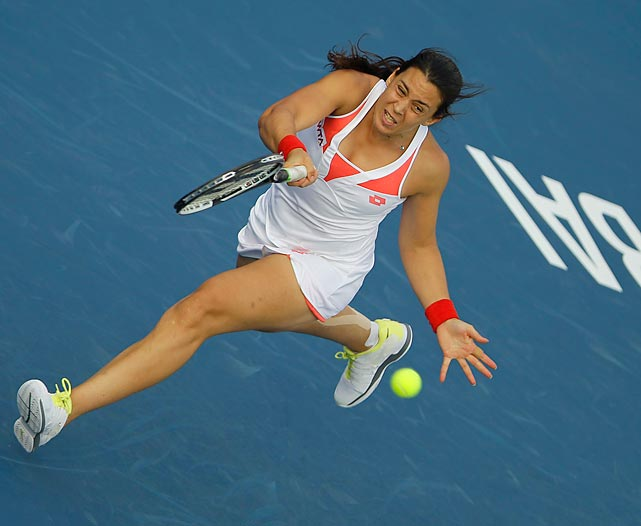 Marion Bartoli returns a ball against Klara Zakopalova during the first day of the Dubai Duty Free Tennis Championships in Dubai, United Arab Emirates on Feb. 18. Bartoli rebounded from dropping the first set to win the match 3-6, 6-4, 6-1.