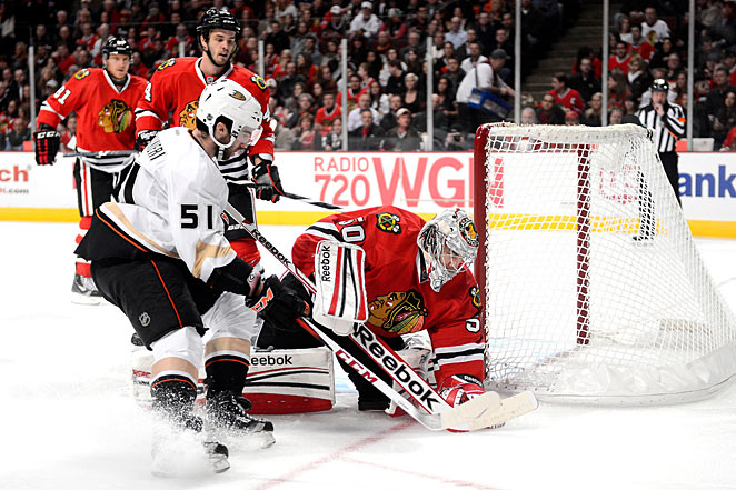 Corey Crawford's injury was a concern as the Blackhawks closed in on the Ducks' NHL fast start mark.