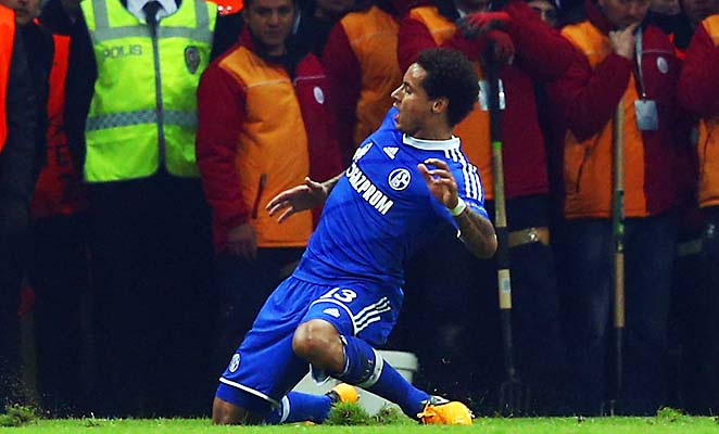 Jermaine Jones celebrates his goal, the second by an American in a Champions League knockout match.
