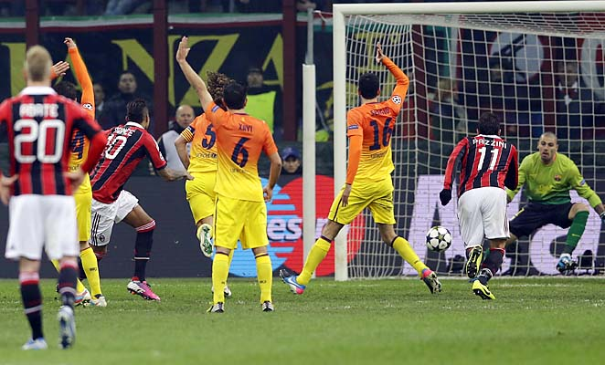 Kevin-Prince Boateng (left, in red) scores the first of AC Milan's two goals on Wednesday.