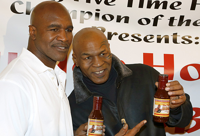 Mike Tyson (right) claims he was embezzled of more than $300,000 and millions more in earnings.