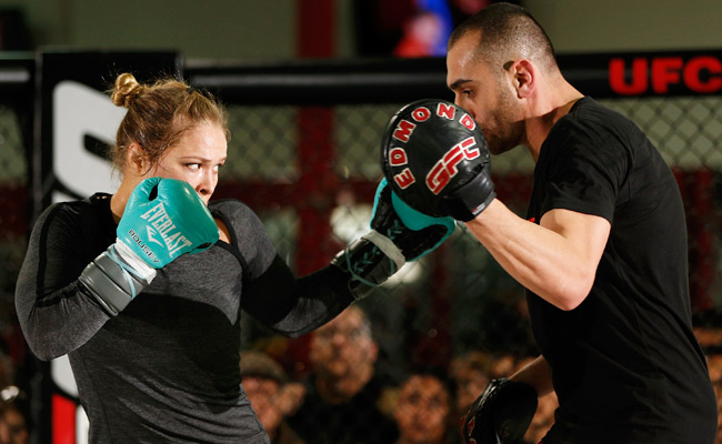 Ronda Rousey works out with trainer Edmond Tarverdyan as she prepares for her UFC 157 fight.