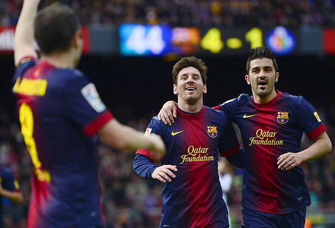 Lionel Messi (center) and Barcelona lost 2-0 to AC Milan in their Champions League first leg Wednesday.