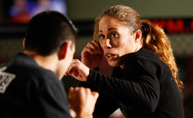 Liz Carmouche (8-2) started her professional MMA career in 2010 after completing her military service.