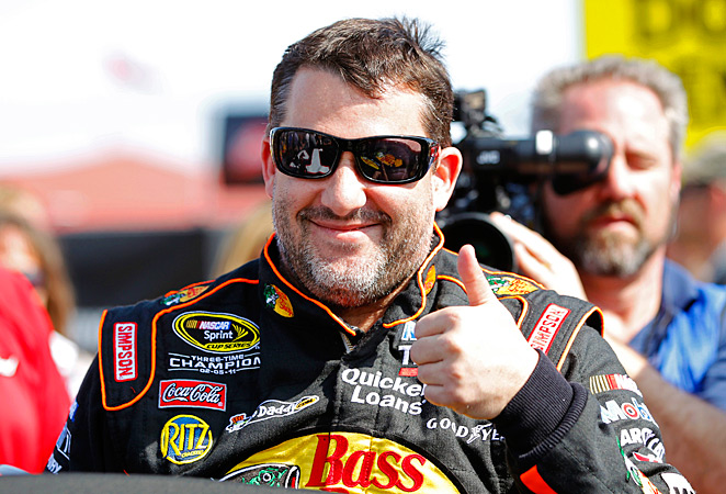 Tony Stewart slid through a late crash to win the Nationwide race at Daytona.