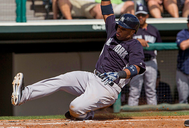 Robinson Cano smashed a home run as the Yankees won their spring training opener.