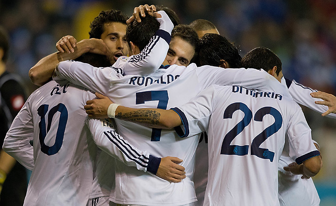 Real Madrid gathers to celebrate after Gonzalo Higuain scored the eventual game-winning goal.