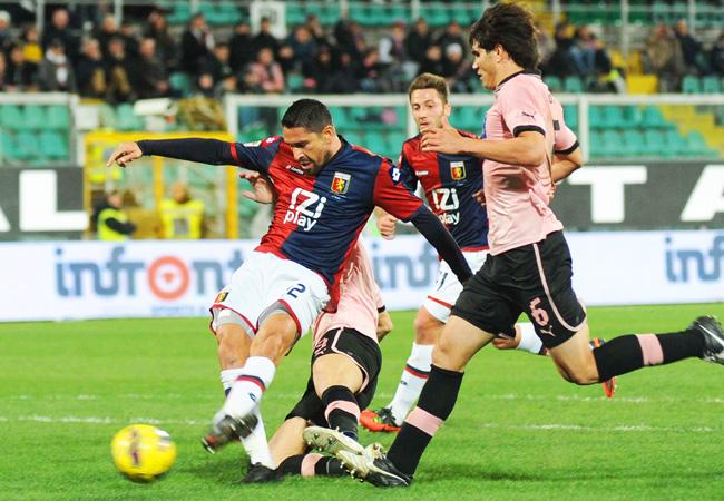 Genoa's Marco Borriello takes a shot on goal against Palermo.
