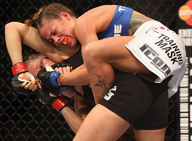 Ronda Rousey improved her record to 7-0 with a first-round victory over Liz Carmouche but found herself in trouble early. After she withstood this challenge and took the bout to the mat, she ended it with another armbar.