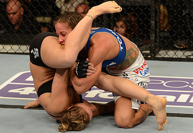 Liz Carmouche lost to Ronda Rousey via armbar with 11 seconds left in the first round of the first UFC female fight in history.