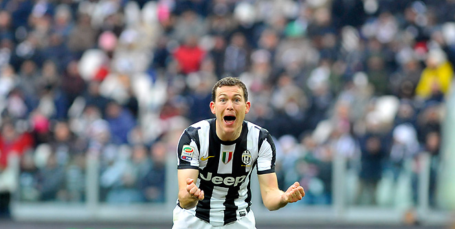 Juventus' Stephan Lichsteiner celebrates after scoring one of Juve's three goals on Sunday.