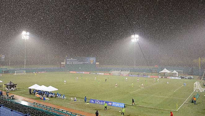 Heavy snow falls during a Red Bulls-Sounders game in Tucson, Ariz., last week.