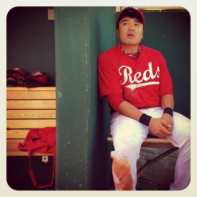 Shin-Soo Choo of the Reds watches a spring training game against the Indians in Arizona.