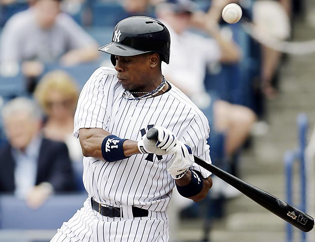 New York Yankees center fielder Curtis Granderson grimaces after taking a pitch from the Toronto Blue Jays' J.A. Happ off of his right foreman. Although the Yankees originally called it a bruise, X-rays revealed Ganderson had broken his arm, leaving New York without its top slugger for 10 weeks.