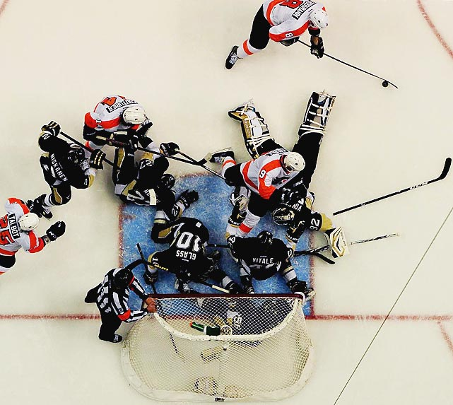 A scrum breaks out in front of the Pittsburgh Penguins' net in a game against the intrastate-rival Philadelphia Flyers on Feb. 20 in Pittsburgh. The Flyers won a wild back-and-forth game in which they scored four consecutive goals only to have the Penguins tie the game with just more than two minutes remaining. Jakub Voracek scored with 1:31 left to complete his hat trick and clinch the win, 6-5.
