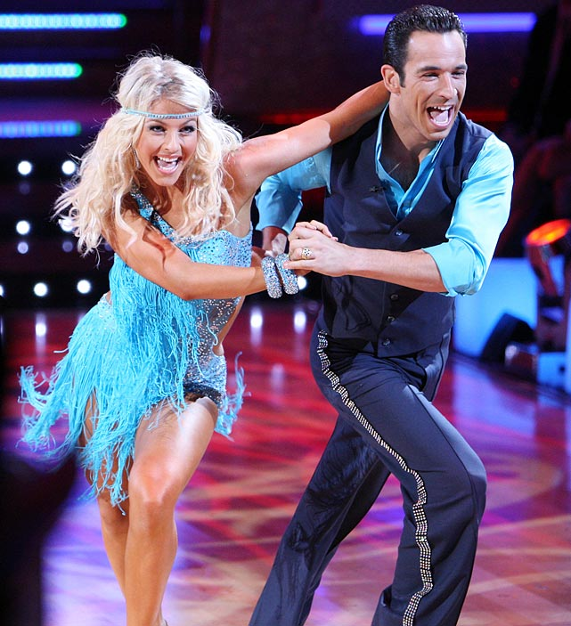 The IndyCar racer won 1st place with dancing partner Julianne Hough (pictured) in Season 5 and finished 10th with partner Chelsie Hightower in Season 15's <italics>Dancing with the Stars: All-Stars.</italics>