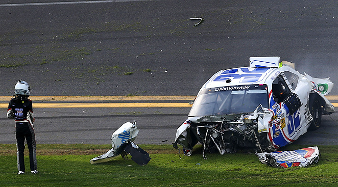 Driver Kyle Larson amazingly walked away from the crash which tore his car in half.