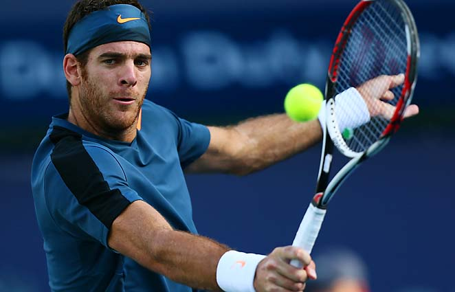 Juan Martin del Potro hit with Diego Maradona after winning his quarterfinal Wednesday.