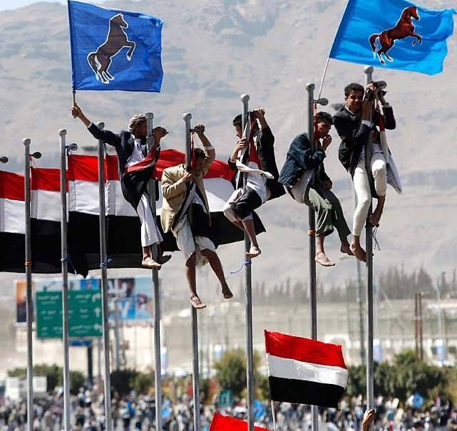 Supporters of Yemen's former president jockey for pole position during a rally marking the anniversary of his power handover.