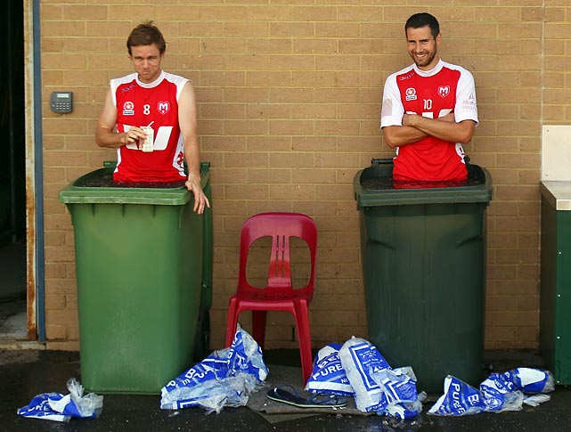 Icing the kickers: Two Melbourne Hearts chill out after their A-League soccer training session in Melbourne, Australia.