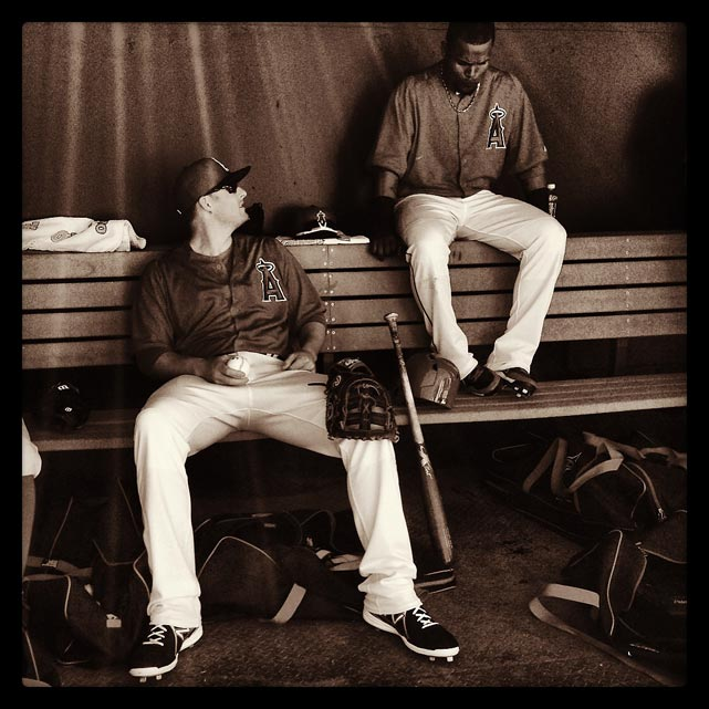 Mark Trumbo and Erick Aybar of the Angels gang out in the dugout before a spring training game against the Dbacks in Arizona.