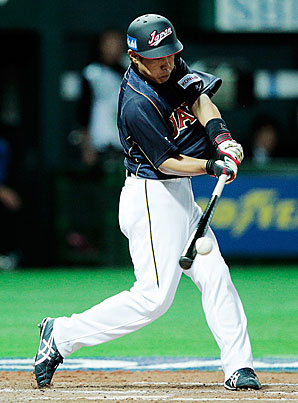 Hirokazu Ibata delivers the game-tying single in the top of the eighth inning as Japan rallies at the Fukuoka Dome.