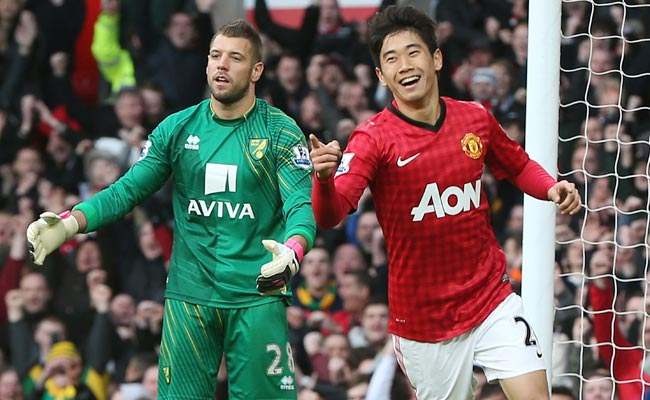 Shinji Kagawa celebrates his second of three goals against Norwich City on Saturday.