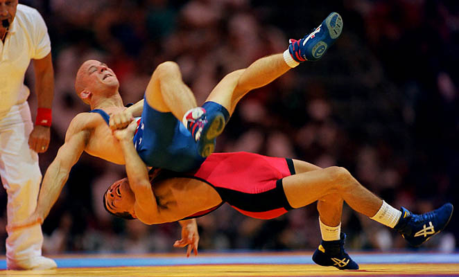 Armenia's Armen Nazaryan (bottom) throws American Brandon Paulson to the mat at the 1996 Olympics.