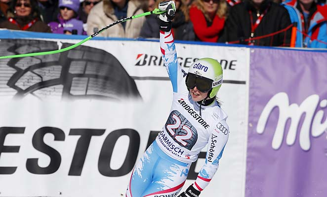 Anna Fenninger of Austria celebrates after crossing the finish line in first place.