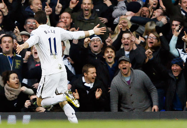 Gareth Bale celebrates after scoring in the first half and putting Tottenham ahead of Arsenal, 1-0.