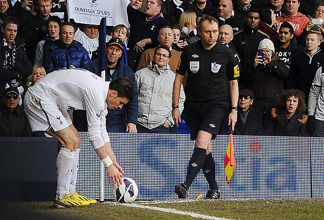 The banana thrown near Gareth Bale rests between the official's feet.
