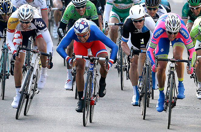 France's Nacer Bouhanni, center, outpedaled Italy's Alessandro Petacchi, right, to win the first stage of Paris-Nice.