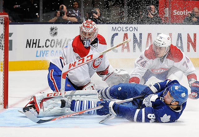 Toronto Maple Leafs center Mikhail Grabovski crashes Montreal Canadiens goaltender Carey Price's net during a Feb. 27 game in Toronto. Two goals from left winger Max Pacioretty helped the Canadiens avenge a 6-0 home loss to the Maple Leafs on Feb. 9 with a 5-2 triumph.