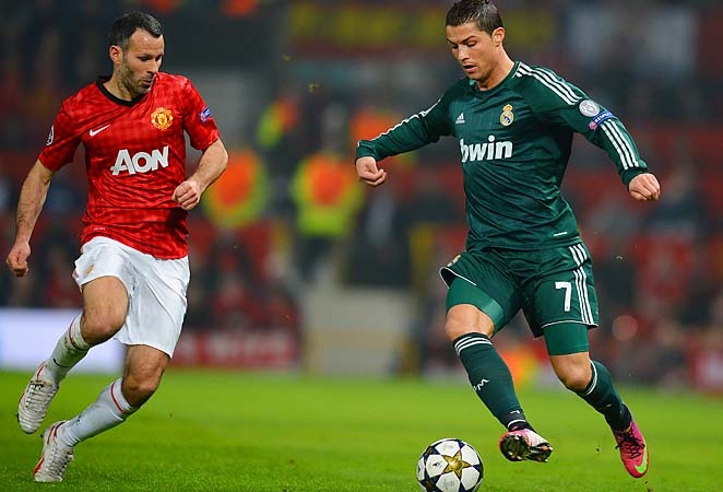 Cristiano Ronaldo (right) ruined Ryan Giggs' (left) 1,000th career appearance.