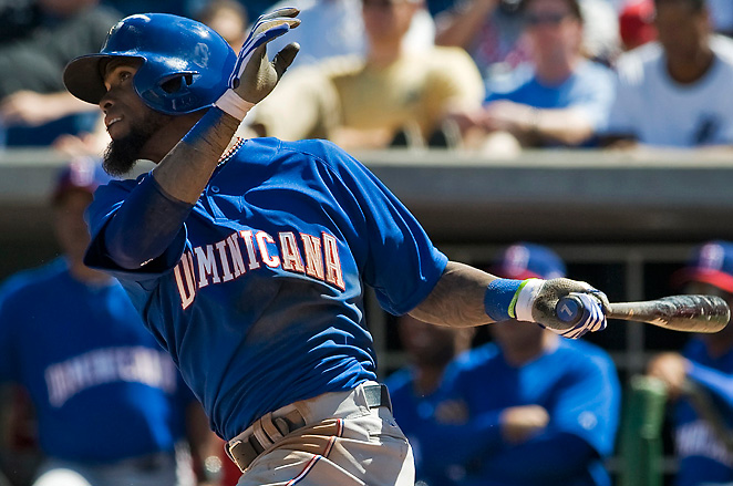 Jose Reyes clubs a two-run home run during the Dominican Republic's 15-2 rout of the Phillies.