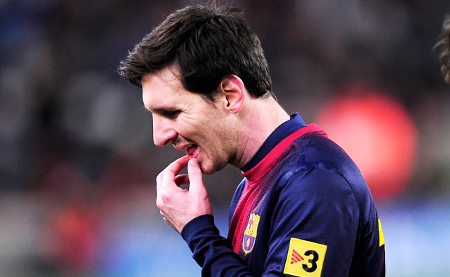Lionel Messi reacts after losing to Real Madrid in the Copa del Rey on Feb. 26 in Barcelona.