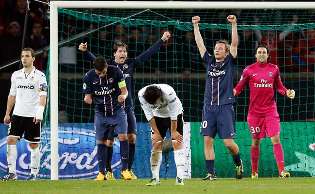 PSG players celebrate after eliminating Valencia and advancing to the Champions League quarterfinals.