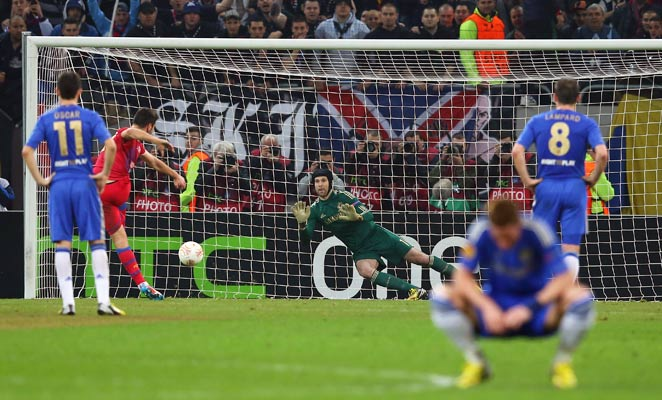 Steaua Bucharest's Raul Rusescu converts a first-half penalty as Fernando Torres looks away.