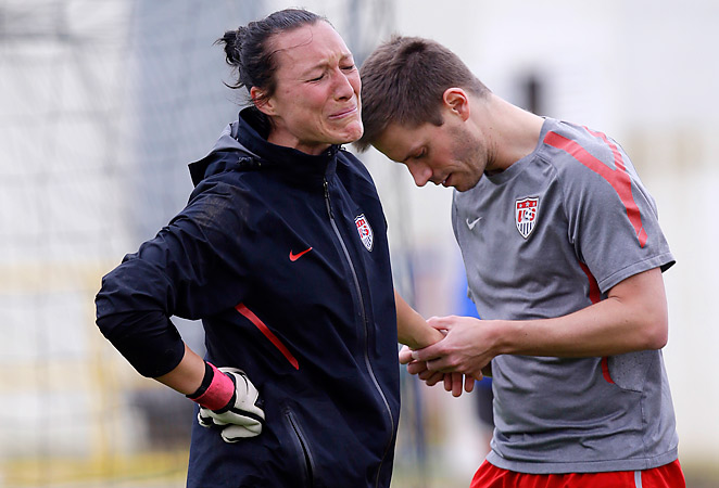 Jill Loyden is inspected by a trainer after injuring her hand in training Thursday. Loyden was later diagnosed with a broken hand and will miss three months, including the remainder of the Algarve Cup.