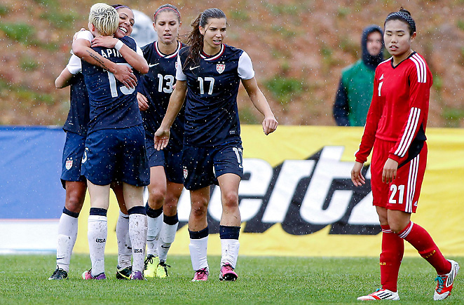 The U.S. women celebrate one of their five goals during the team's 5-0 rout of China.